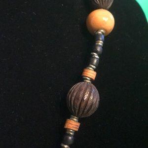 unbranded Jewelry - Wood-like tribal beaded elephant pendant necklace